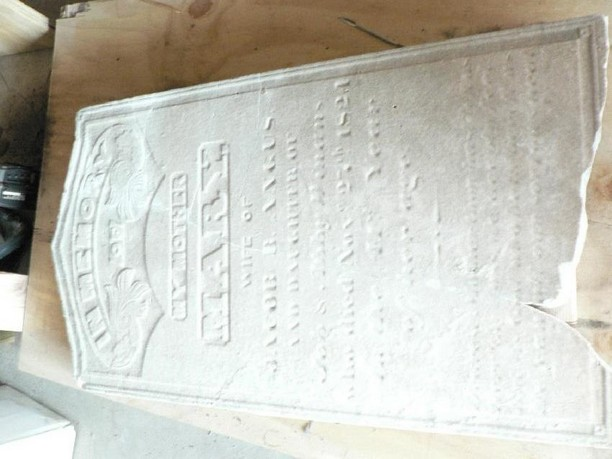Damaged grave marker, after conservation